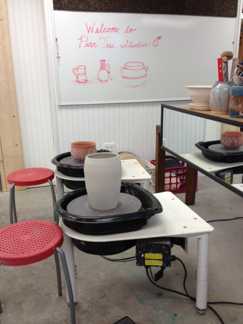 in the studio are four wheels used for instruction with mirrors across from the potter to allow students to have an overall ability to see their work